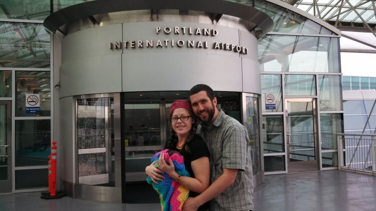 adoptive parents with baby at airport