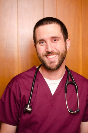 joel nurse in scrubs with stethoscope